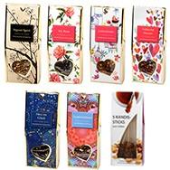 Teegeschenk goldenes Herz mit 6 ausgesuchten Teesorten und Kandissticks